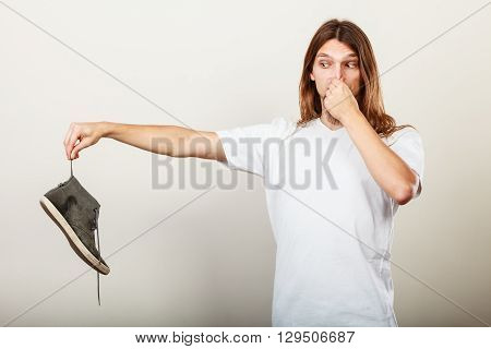 Man With Stinky Shoe