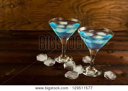 Blue Curacao liqueur served in Martini glass. Blue cocktail. Blue Martini. Blue Hawaiian cocktail. Blue curacao liqueur. Blue margarita. Blue Lagoon