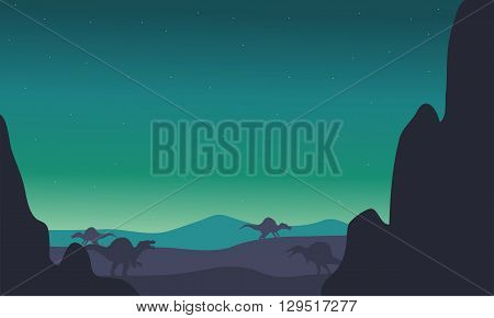 spinosaurus silhouette in hills with green backgrounds