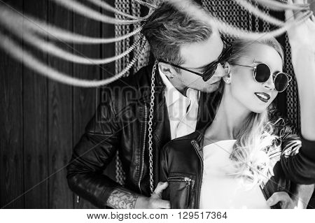 Outdoor fashion portrait of young beautiful couple. Valentine's Day. Love. Wedding. Black and white