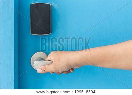 Hand Holding On Stainless Steel Door Handle In Hotel