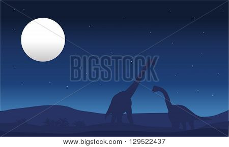 brachiosaurus and moon silhouette at the night