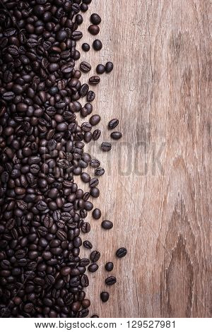 Coffee Beans On Wooden Background, Composition With Free Space Of Wood