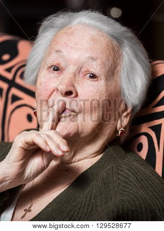 Old Woman With Finger On Lips