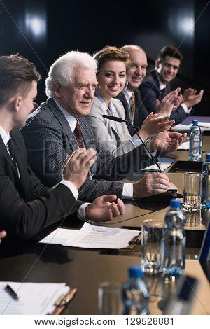 Applauding Mature Businessman