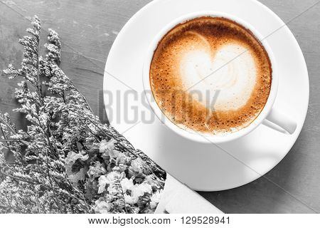 Coffee cup with beautiful flower background, stock photo