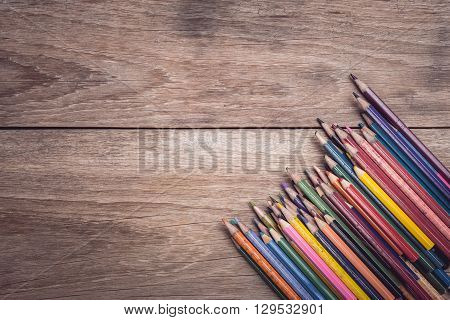 Pile Of Old Color Pincil On Wooden Table Top View