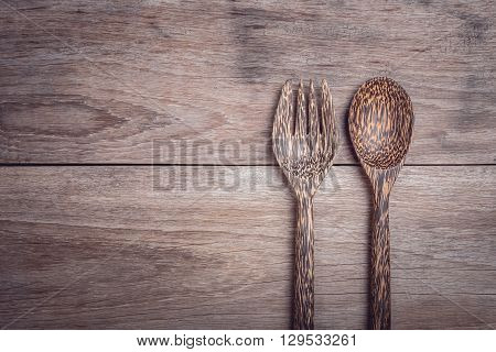 Palm Wood Spoon On Wooden Table Top View