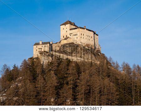 Tarasp Castle - fortified mountain castle in Swiss Alps, Engadin, Switzerland.