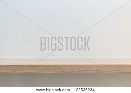 Empty Top Of Wooden Shelf On White Cement Wall Background