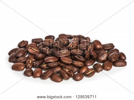 heap of coffee beans isolated on white background