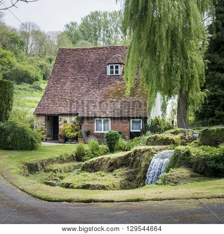LOOSE, KENT, UK, 11 MAY 2015 - Old cottage with waterfall in the garden in the pretty village of Loose Kent UK