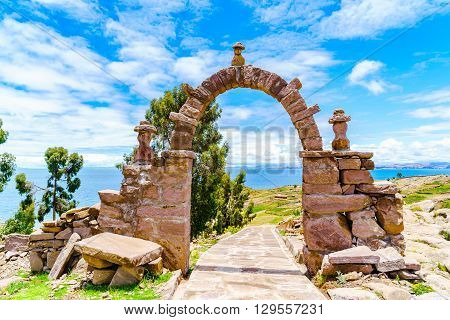 The stone arch leading to the main square of Taquile Island in Lake Titicaca Puno Peru