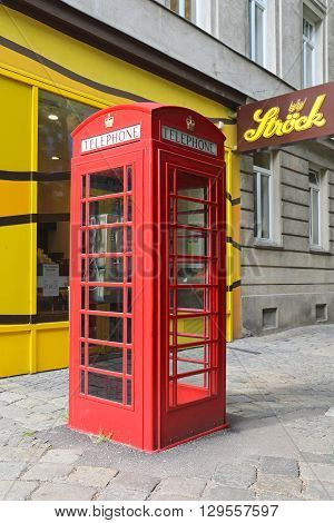 VIENNA AUSTRIA - JULY 12: Red Telephone Box in Wien on JULY 12 2015. Famous British Phone Booth Cabin in Vienna Austria.
