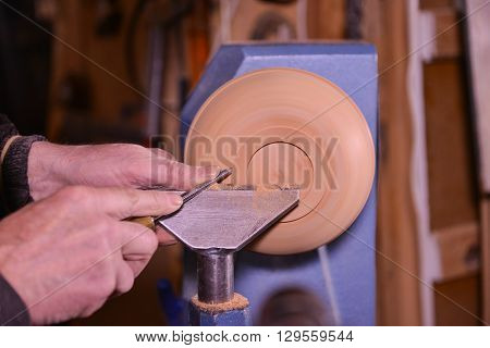 Woodturners Using A Rotating Clamp To Turn The Wood.