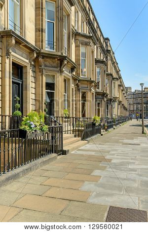 Prime residential property in Drumsheugh Gardens in the west end of Edinburgh. The buildings are constructed with Blonde sandstone.