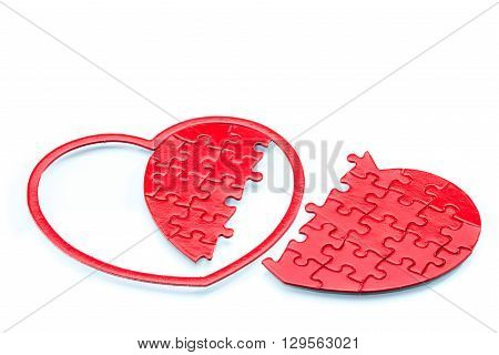 Split heart-shaped puzzle on white background relation broken