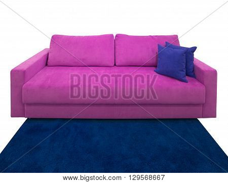 Pink sofa with pillows on the blue carpet