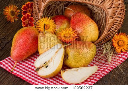 Basket of  pears fruits in retro style. Thanksgiving Day decoration.