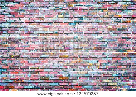 a brick wall colored mosaic for backgrounds