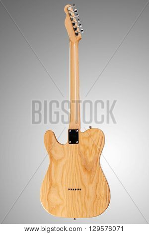 Wooden telecaster form six string guitar on neutral background