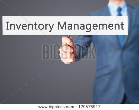 Inventory Management - Businessman Hand Holding Sign