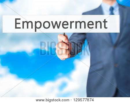 Empowerment - Businessman Hand Holding Sign