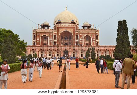 NEW DELHI INDIA - OCTOBER 27 2015: Humayun's Tomb. Tourist gather at the one of the most famous Mughal buildings in New Delhi.