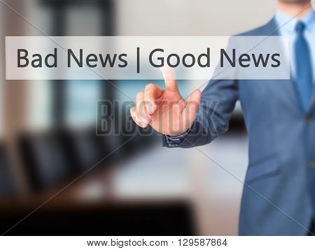 Good News Bad News - Businessman Hand Pressing Button On Touch Screen Interface.