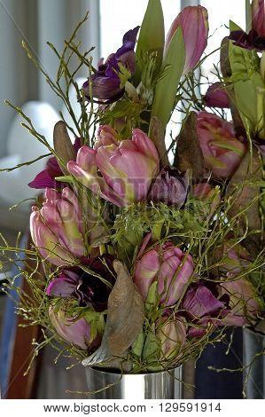 beautful tulip spring flower bouquet in vase