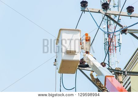 Close up basket of Rescue Hydraulic Platform changing power cord.