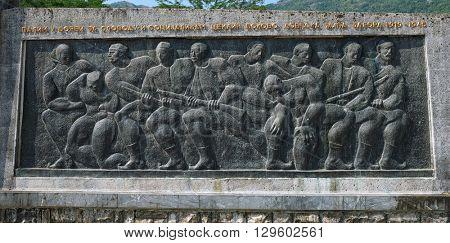 RIJEKA CRNOJEVICA, MONTENEGRO - JULY 14, 2015: Partisan Memorial bas-relief in Rijeka Crnojevica, Montenegro