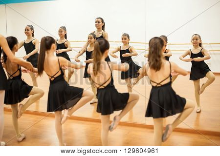 Little Dancers In Front Of A Mirror