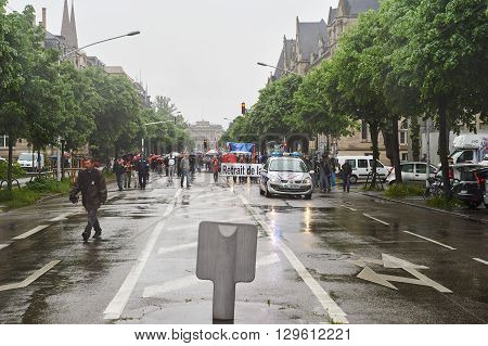 STRASBOURG FRANCE - MAY 12 2016: Retire labor law placard as thousand of people demonstrate as part of nationwide day of protest against labor reforms by France Government
