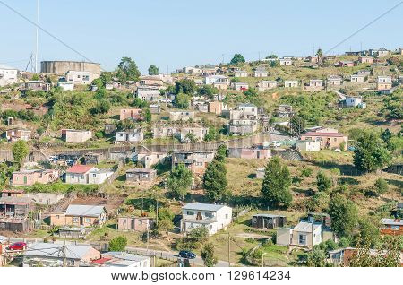 KNYSNA SOUTH AFRICA - MARCH 5 2016: A view of a reservoir and houses on a hill in the Khayalethu township in Knysna