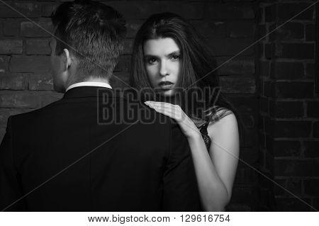 Beautiful Young Woman Kissing Her Boyfriend