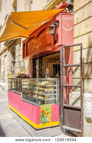 AIX-EN-PROVENCE FRANCE - JUL 17 2014: Sandwich Panninis and Pizza point on the street of the Aix-in-Provence - Typical Provence sweet pastry store in the heart of the city of Aix