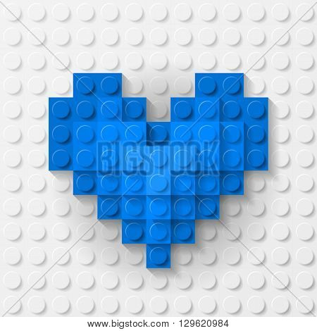 Plastic blue heart on white background made of construction kit