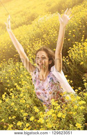 Happy Exultant Girl  In A Flower Field