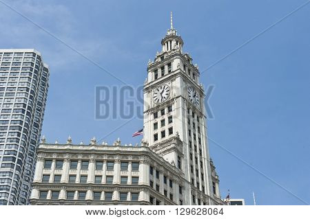View of the skyscraper and clock tower of Wrigley building in Chicago, Illinois. Wrigley building is a tall skyscraper on Magnificent Mile and headquarters to Wrigley Company.