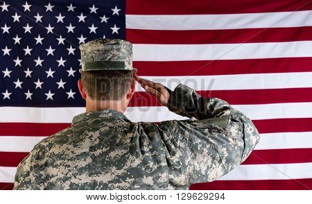 Male Veteran soldier back to camera saluting United States of America flag. poster