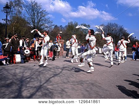 TELFORD, UK - APRIL 28, 1991 - Morris dancers with bells on their legs at the Blists Hill Victorian Town Madeley Telford Shropshire England UK Western Europe, April 28, 1991.