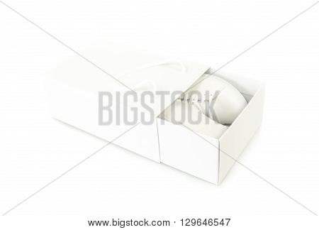 white shoe in a white shoebox on white background