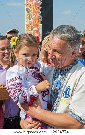 Dnepropetrovsk Ukraine - September 13 2014: Dnepropetrovsk Mayor Ivan Kulichenko holds a child by demonstrating closeness to the people