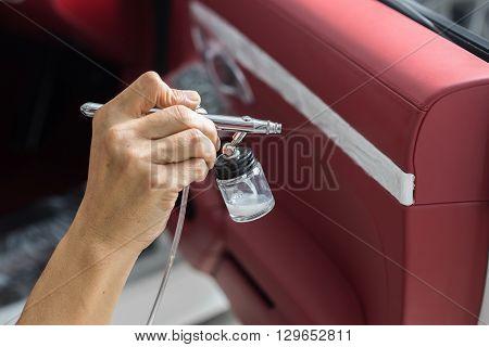 Car detailing series : Closeup of hand coating car door panel