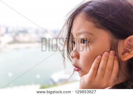 Lonely Kid Looking Through Window