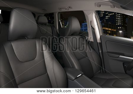 Dark luxury car Interior - steering wheel shift lever and dashboard