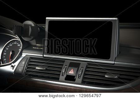Dark luxury car Interior - ac ventilation holes and big black display