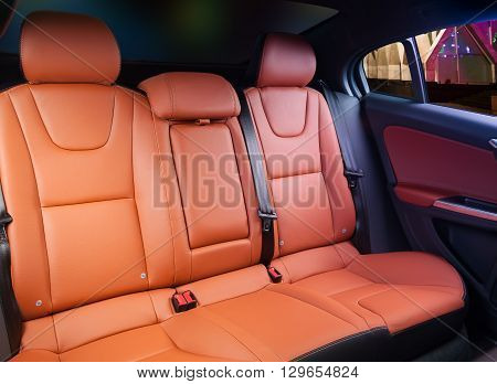 Car interior, back seats with night city in the windows