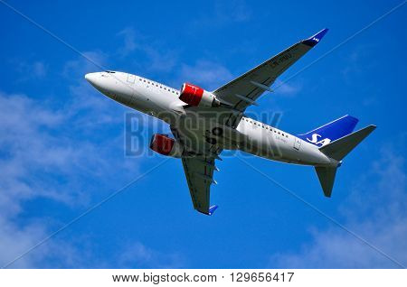 SAINT PETERSBURG RUSSIA - MAY 11 2016. SAS Scandinavian Airlines System Boeing 737 Next Gen -registration number LN-RNU-is flying in the sky after departure from Pulkovo International airport